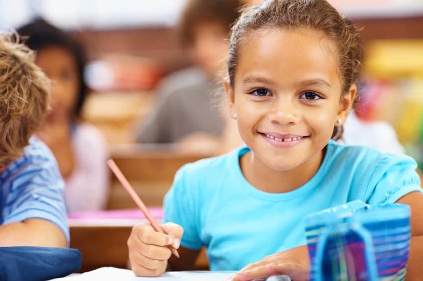 little_girl_writing_in_class.jpg